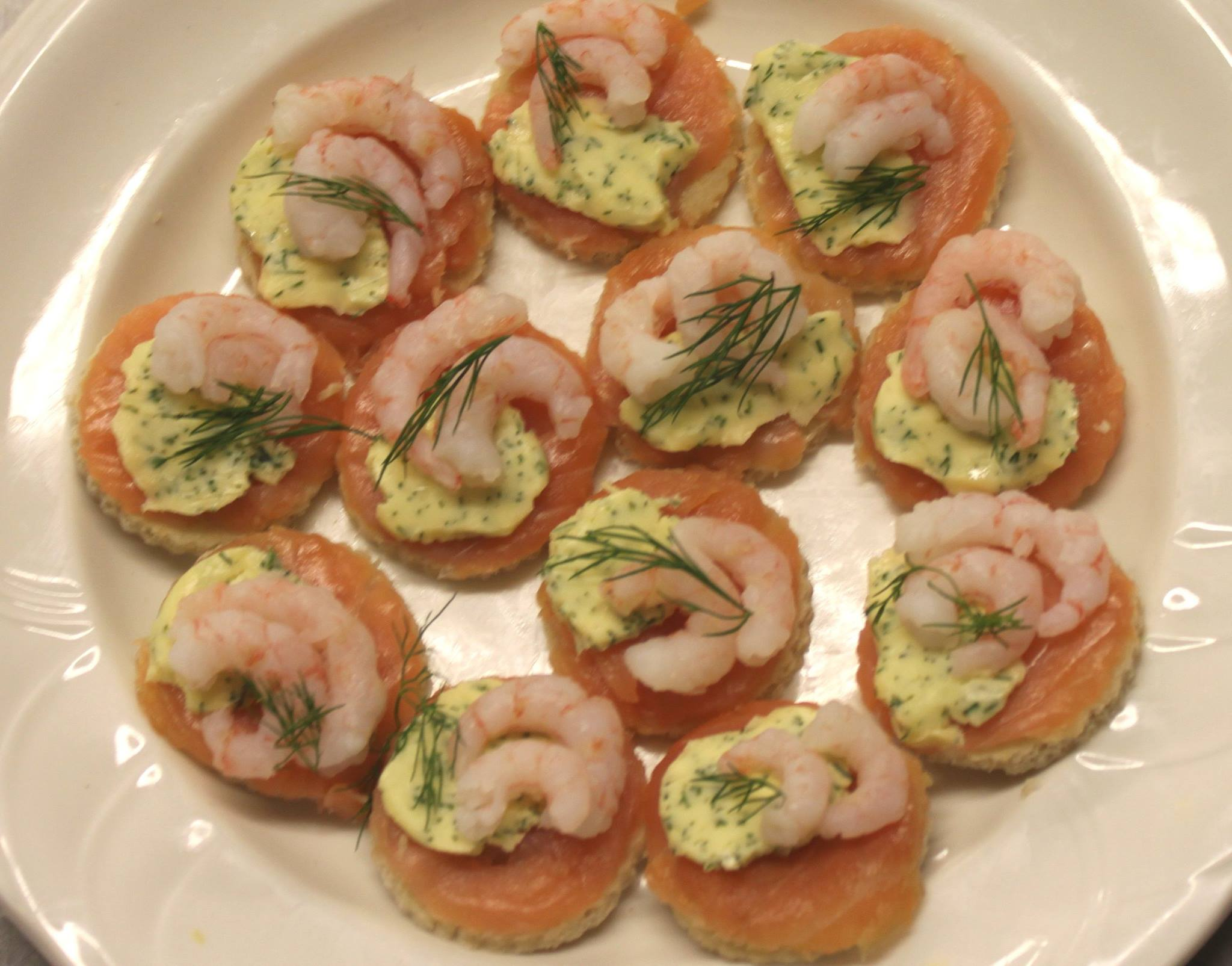 Smoked salmon and dill butter on a crouton canape.