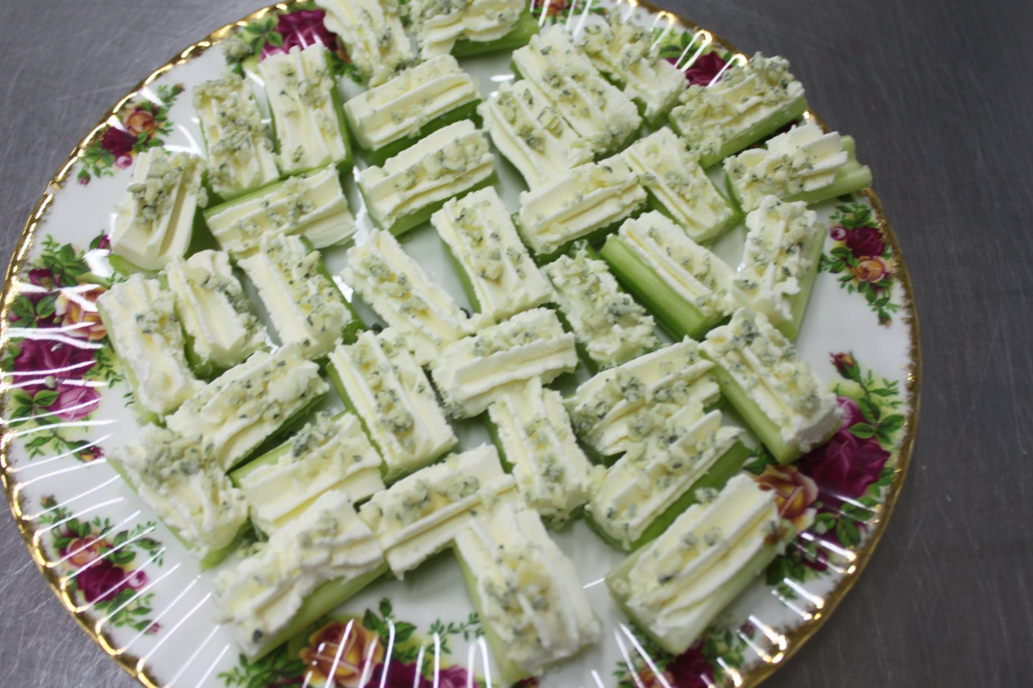 Celery sticks filled with cream cheese topped with Harrogate blue cheese canapes.