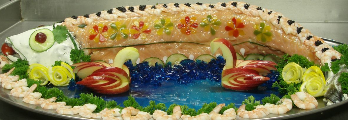 Highly decorated salmon on a sea of blue aspic