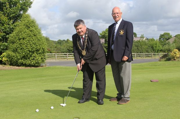 members playing golf