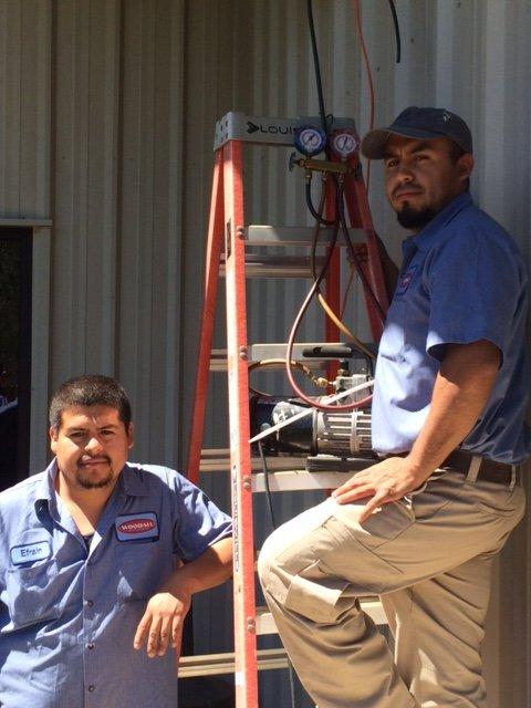 Heating specialist examining boiler in Enterprise