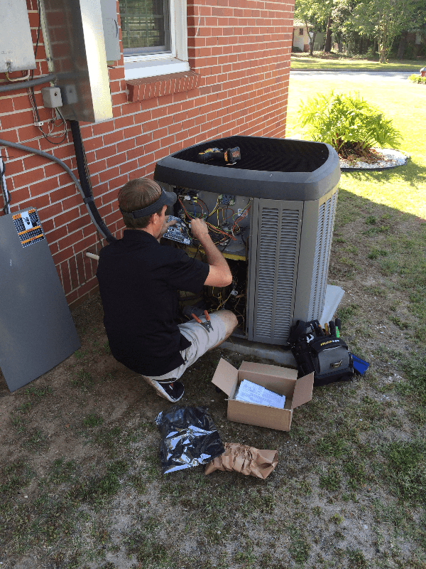 Cooling specialist fixing air conditioning unit in Enterprise
