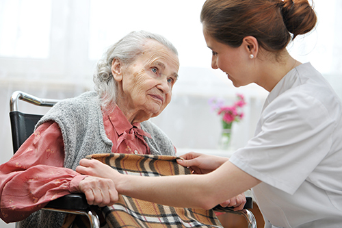 Experienced nurse helping an elderly lady at the hospice care in Poteau, OK