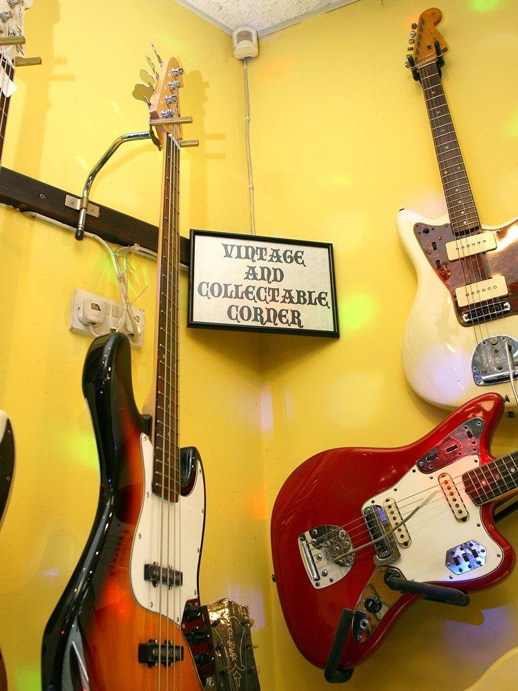 wall-mounted guitars