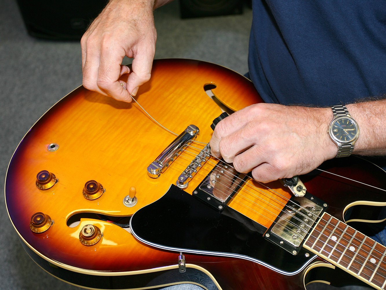 guitar strings being fixed