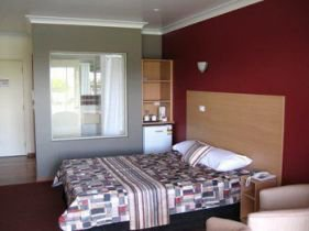 One of Forbes Victoria Inn's motel rooms with red walls
