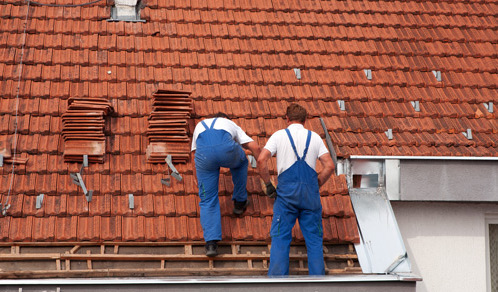 Experts installing residential roofing in Covington