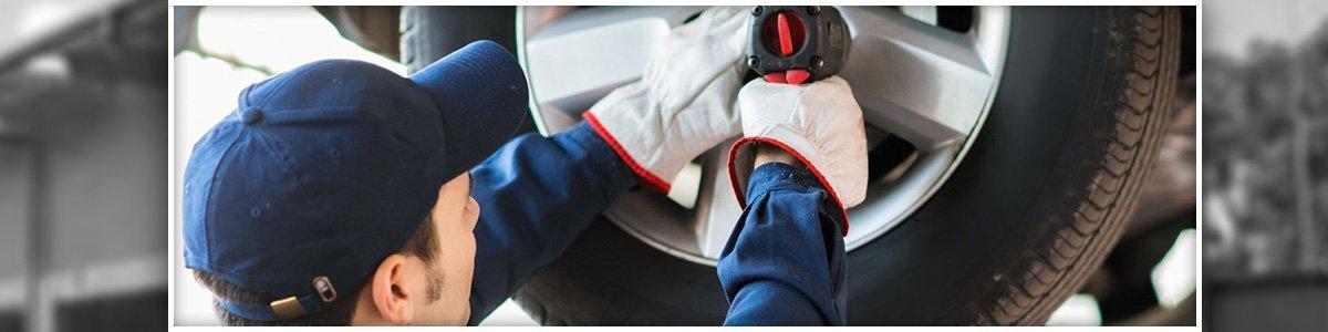 advance tyres mechanic changing car wheel