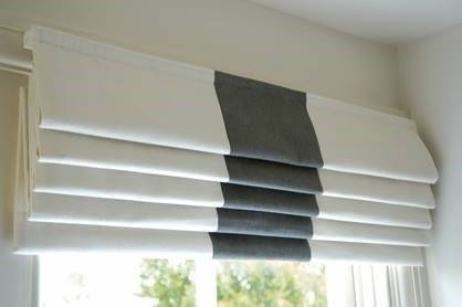 white and grey roman blinds