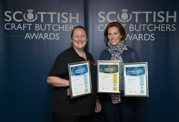 View of professional showing the awards won by Bel's butchers