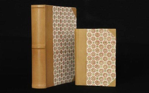 due quaderni portafoto di diverse dimensioni