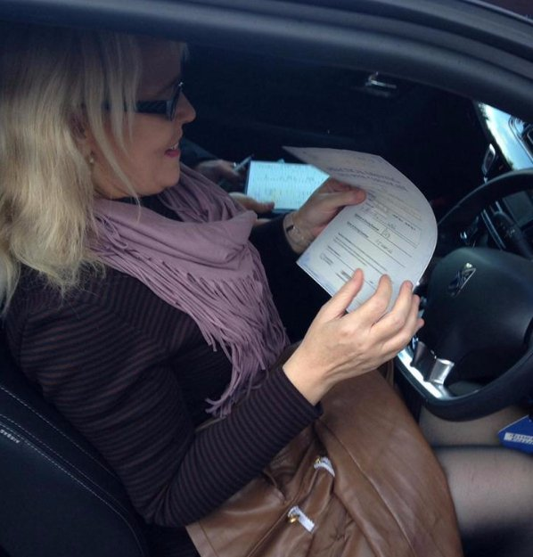 Lady reading the driving manuel