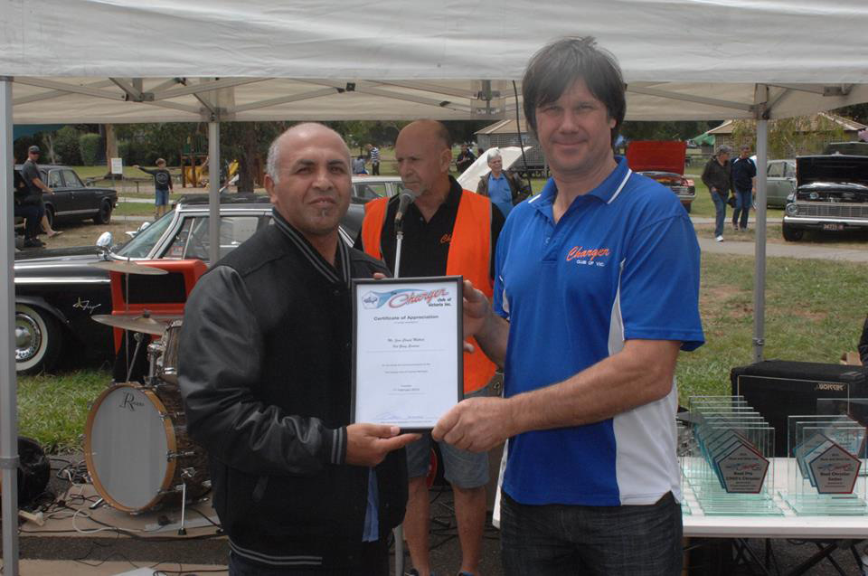 Certificate being awarded to a person at an event