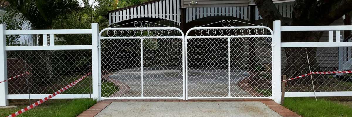 sureline fencing white scroll gates design
