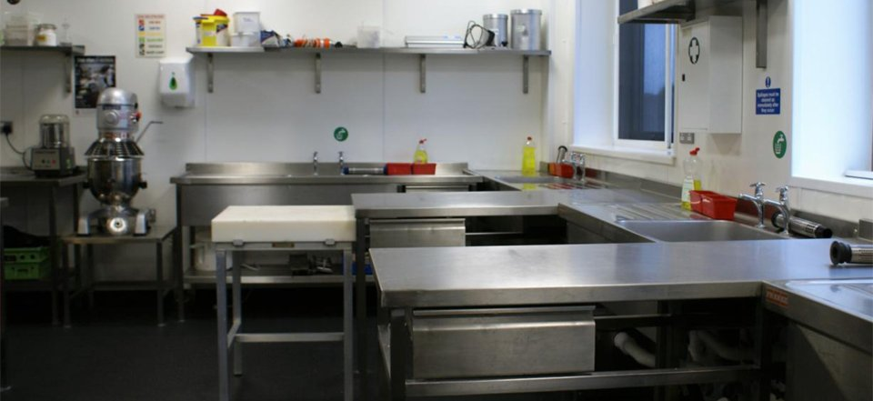 commercial kitchen with stainless steel units