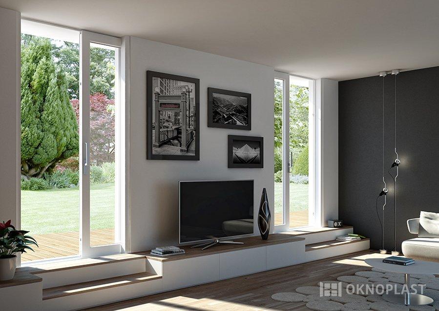 vista interna di un soggiorno con televisione, finestre esterni e arredamenti