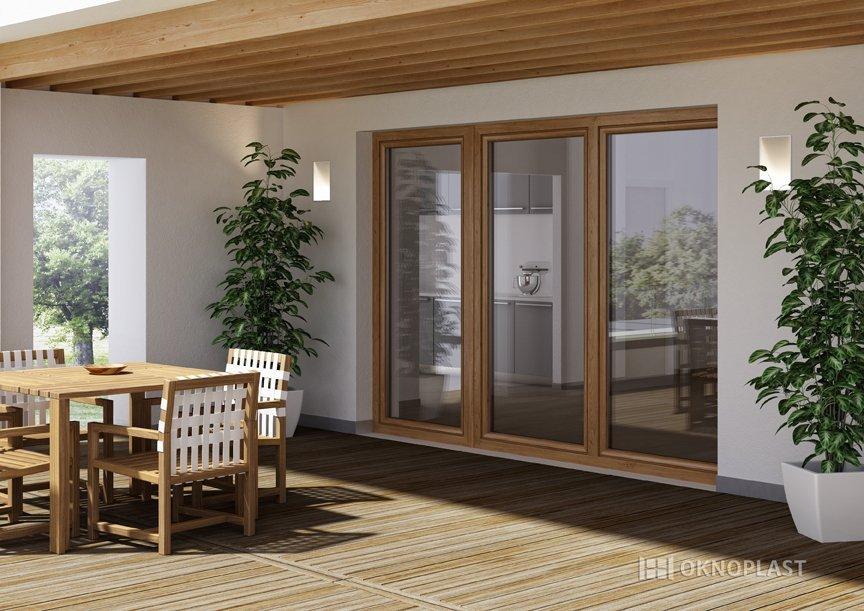sala da pranzo con infissi in PVC e pavimento in legno-Oknoplast