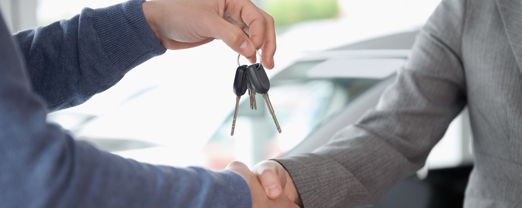 Individual handing over the car keys