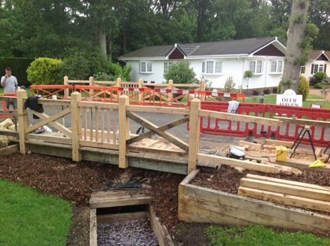 Fence being repaired by expert