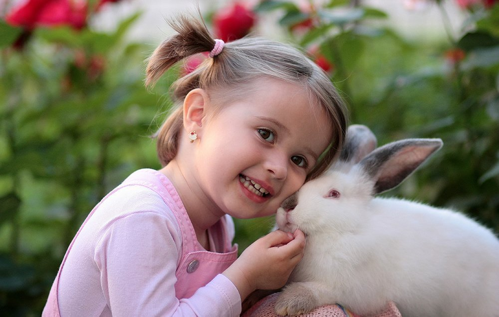 happy young girl with a bunny rabbit