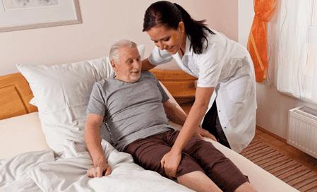 Nurse taking care of an elderly man
