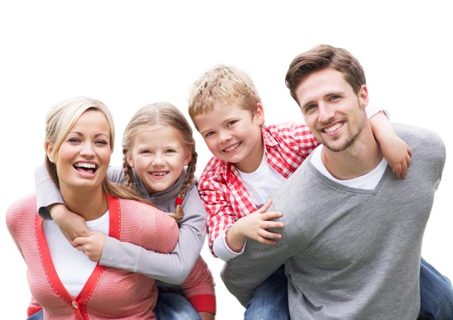 smiling couple with two kids
