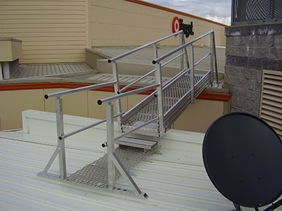 walkway system platform with rails on roof