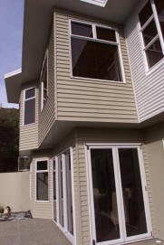 Exterior finish of linea, stucco and coloursteel