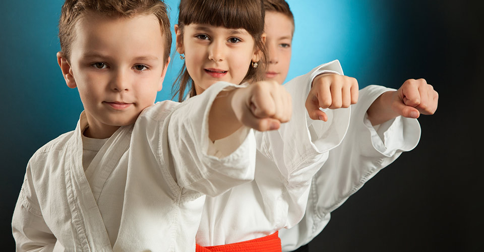 kids having fun practicing karate
