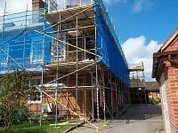 Scaffolding with blue protective sheeting