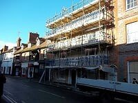 Scaffolding along the front of a commercial building