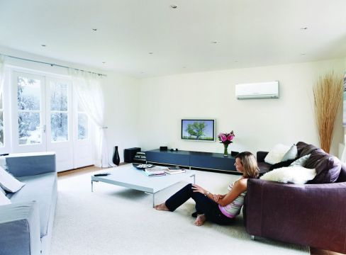 Woman enjoying room with air conditioning in Tauranga