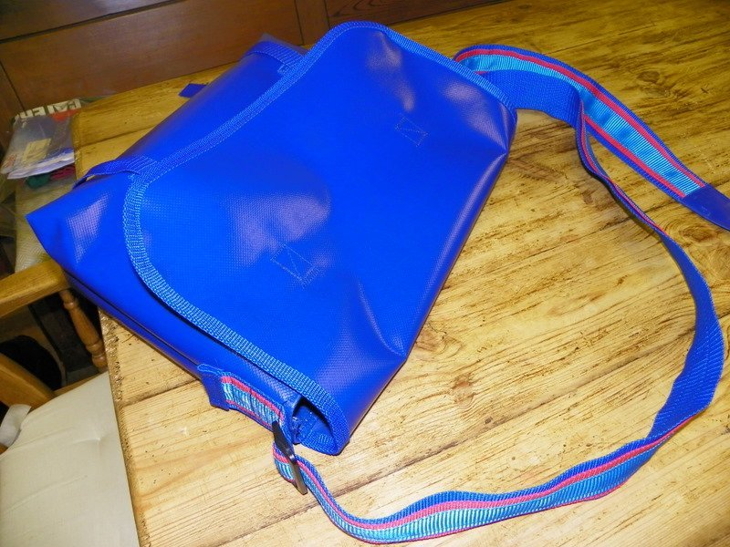 A blue cavas bag with long strap