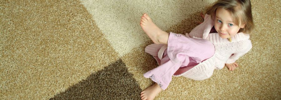 a girl laying on a carpet in Atmore, AL