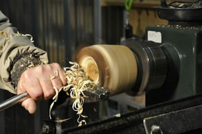 Wood vase being turned on the lathe