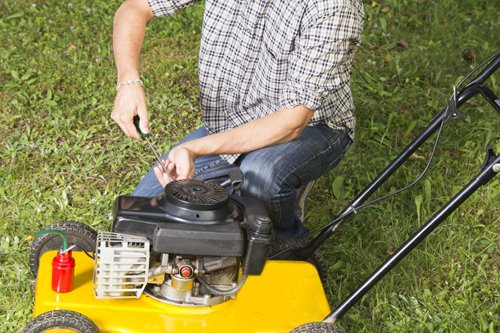 Lawn mover machine being repaired by  professional in Cincinnati, OH