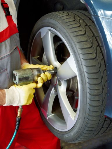 Car being serviced with new tires in Jefferson, GA