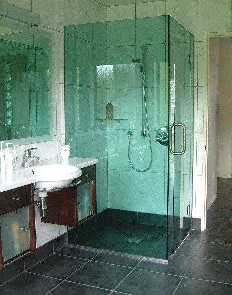 Interior view of bathroom with installed shower cubical