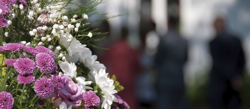 Close up of flowers at a funeral gathering