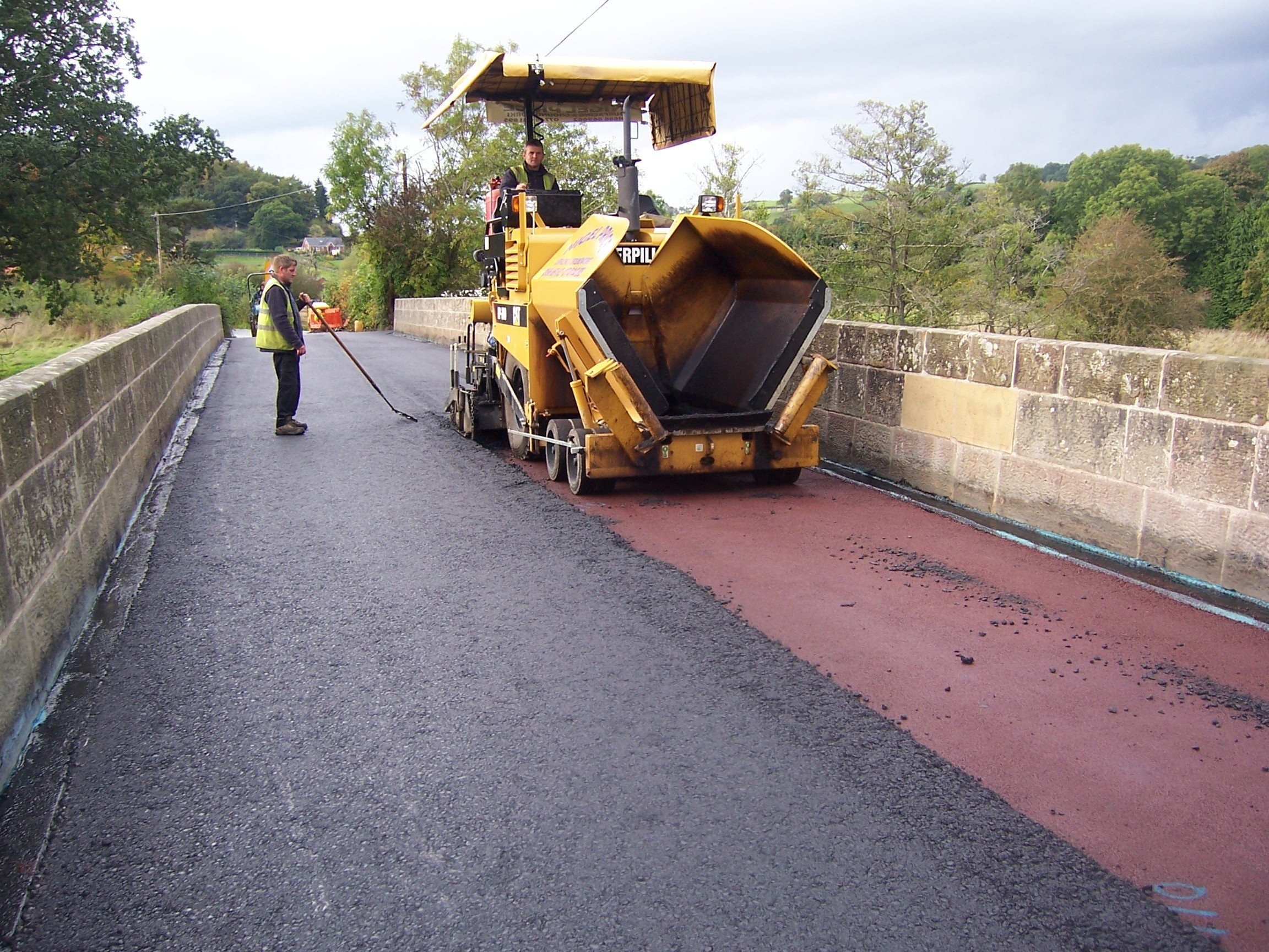 Tarmacadam road laying