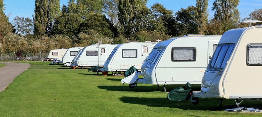 A row of caravans on grass