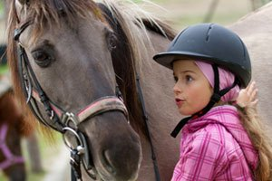 girl ready to be ridden by the horse