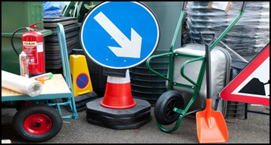Wheelbarrow, traffic cones and various other construction tools