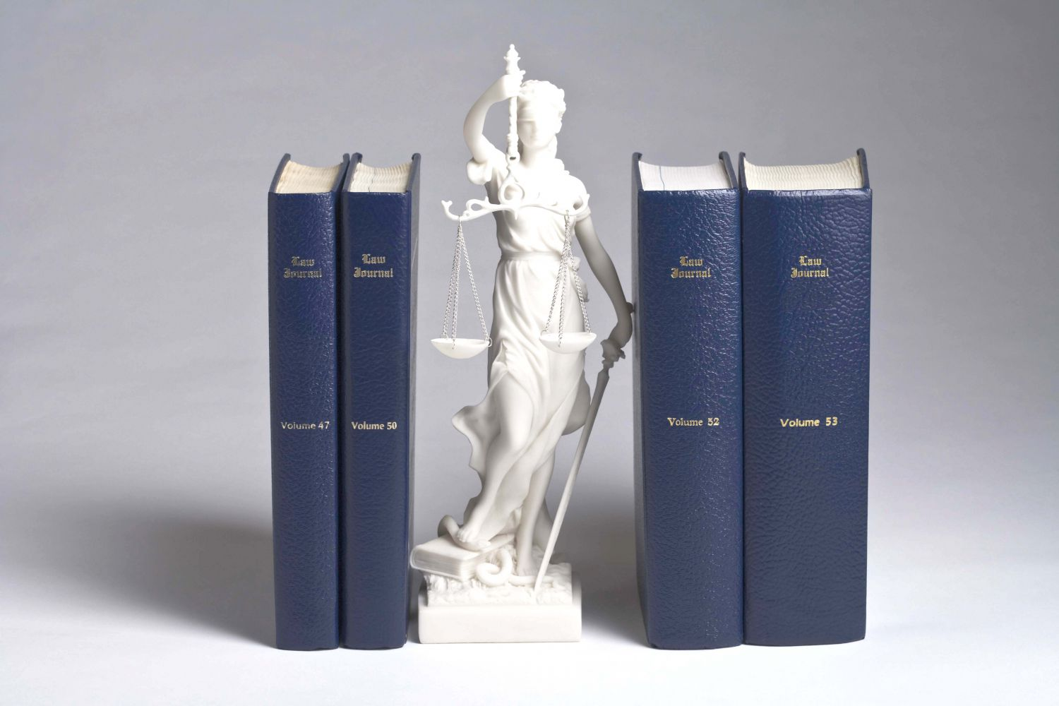 lady justice between law books