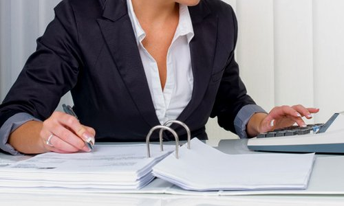 woman working on VAT calculations