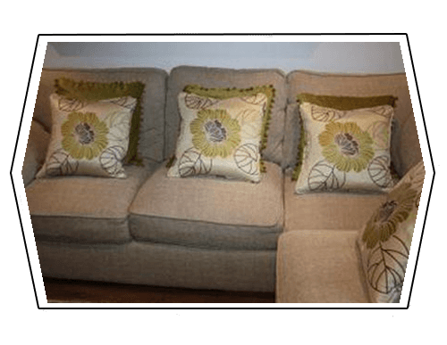 beige coloured sofa