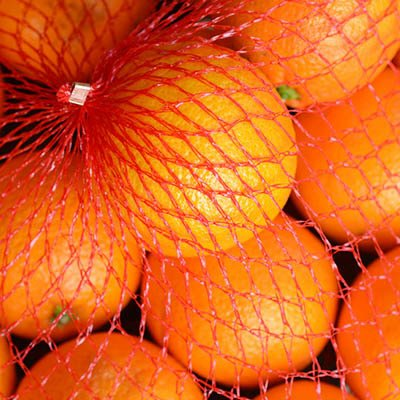 Oranges In Elastic Netting