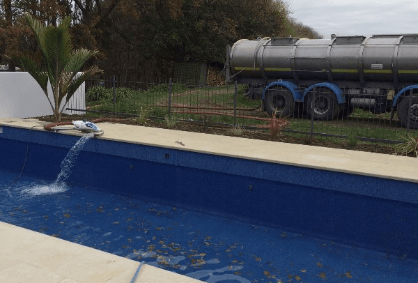Pool being filled with the help of the tanker
