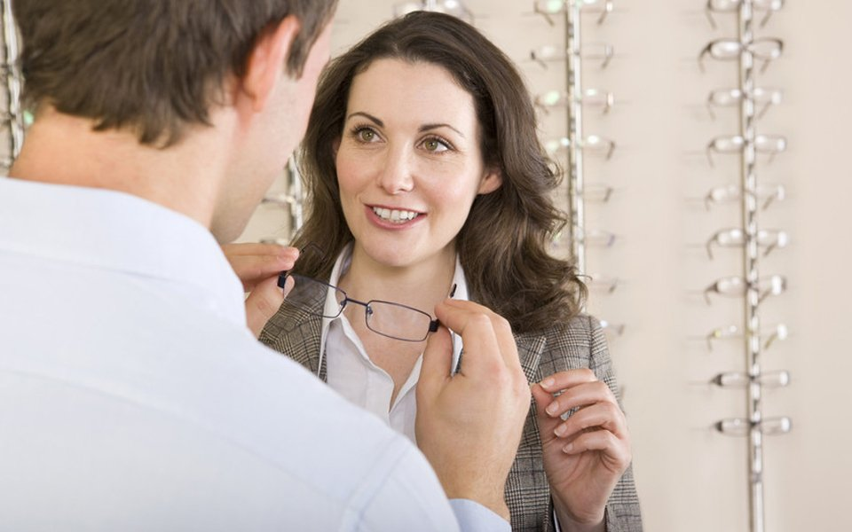 a lady discussing with the optician