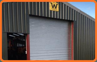 Steel shutter door on warehouse frontage